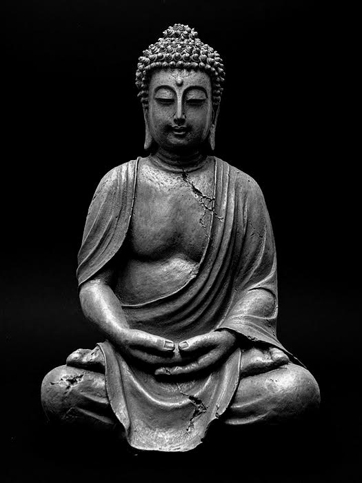 Statue of Buddha, seated, dhyana mudra, in black and white.