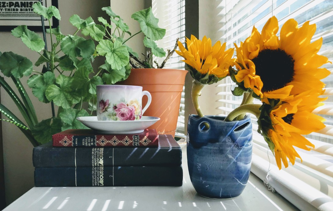 Vintage Larousse Spanish-English dictionaries with teacup and sunflowers